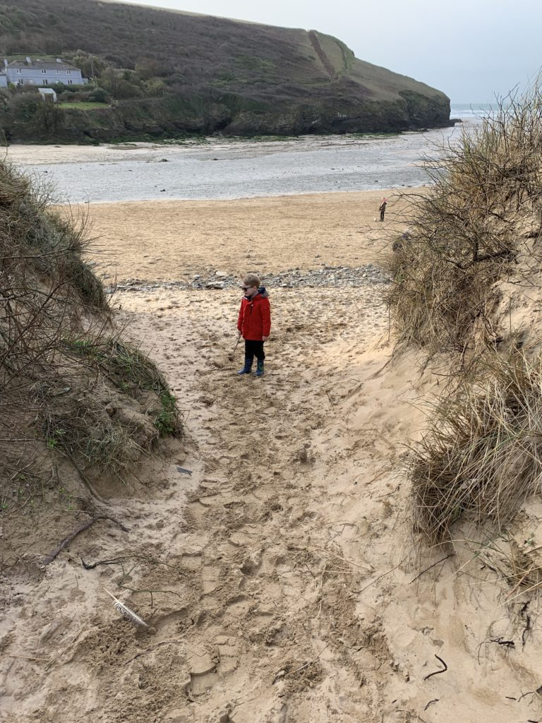A boy on Mawgan Porth beach
