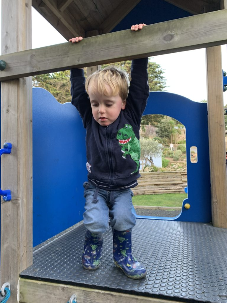 Toddler on a climbing frame