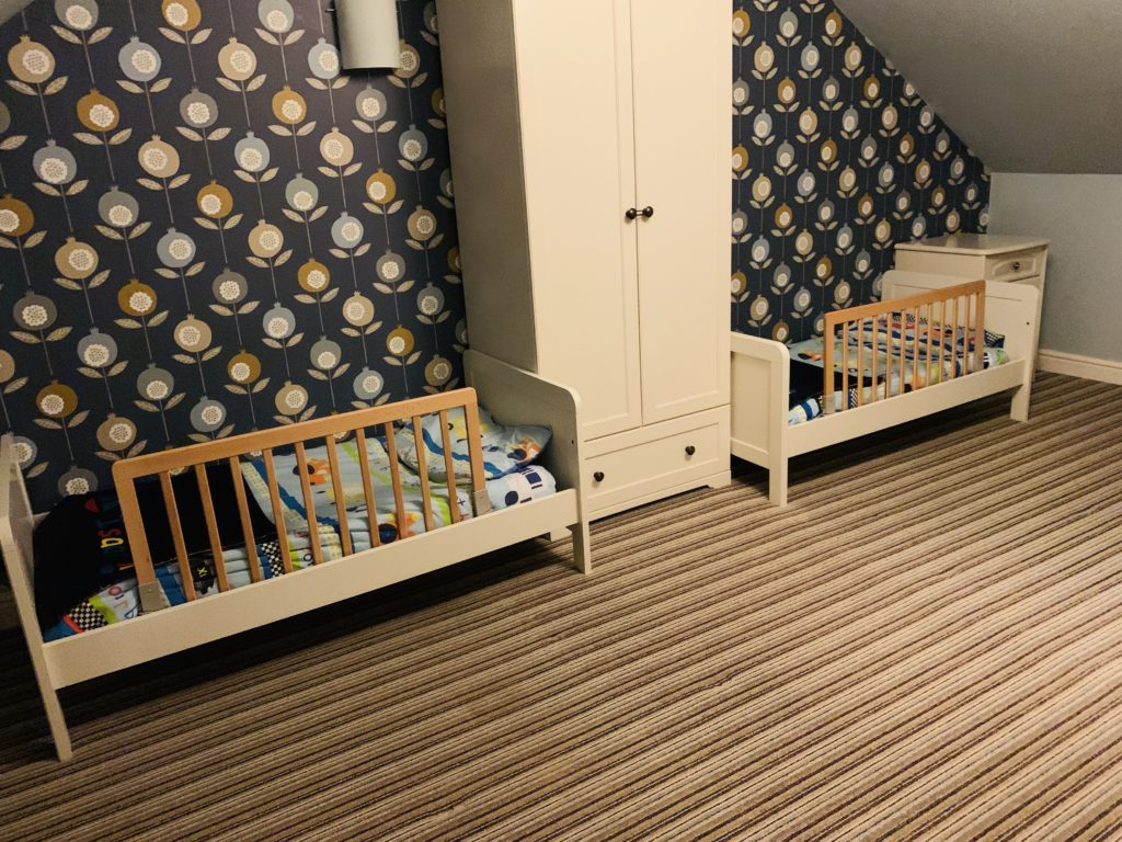Twins bedroom with bed rails