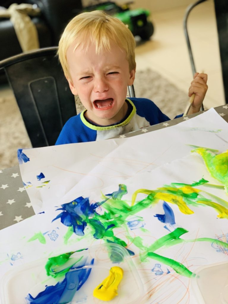 toddler painting and crying