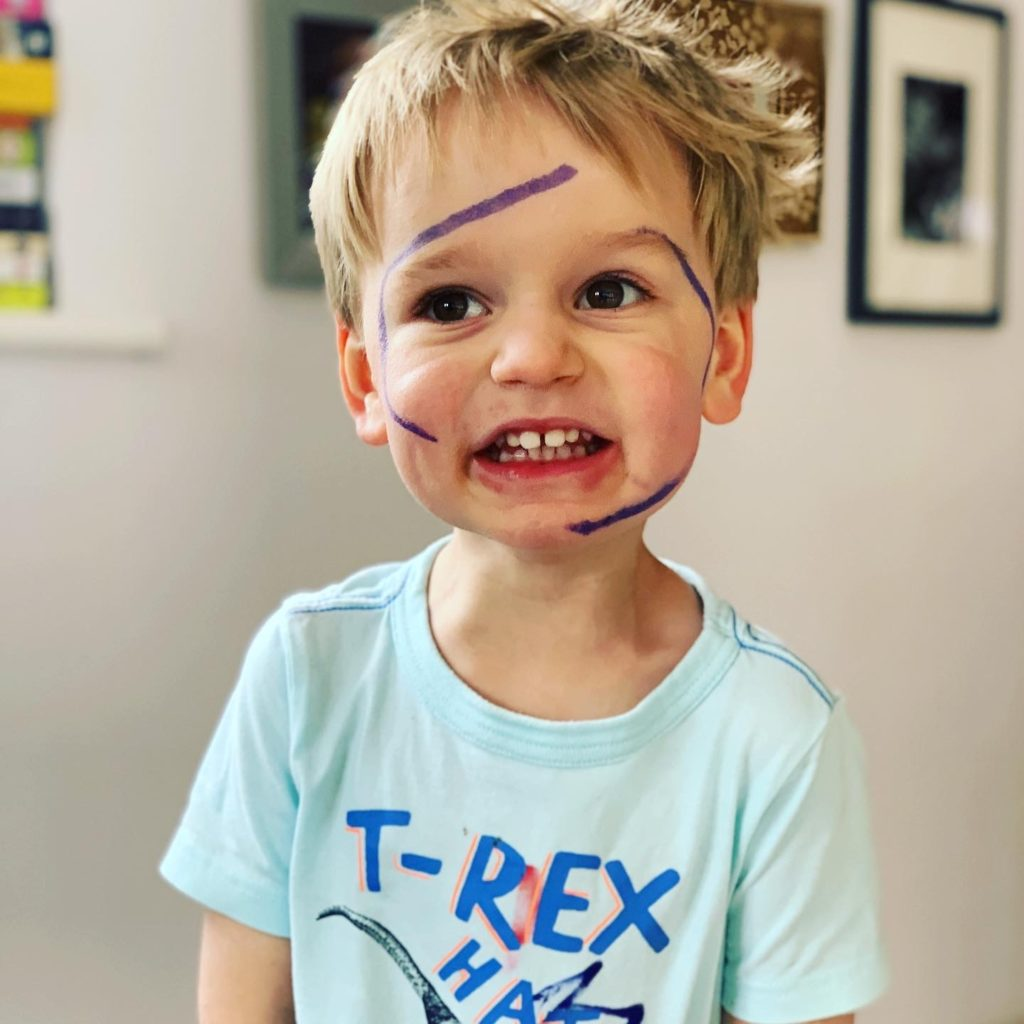 Toddler draws pen all over his face in lockdown