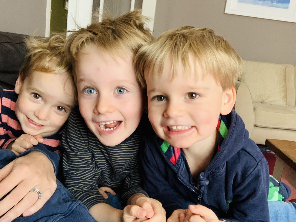 Twin two year old boys and their four year old big brother