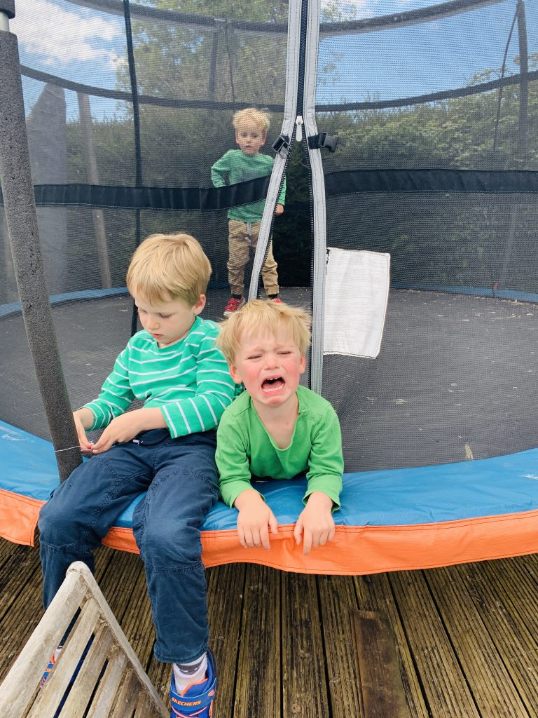Brothers cry on the trampoline before being sent back to school