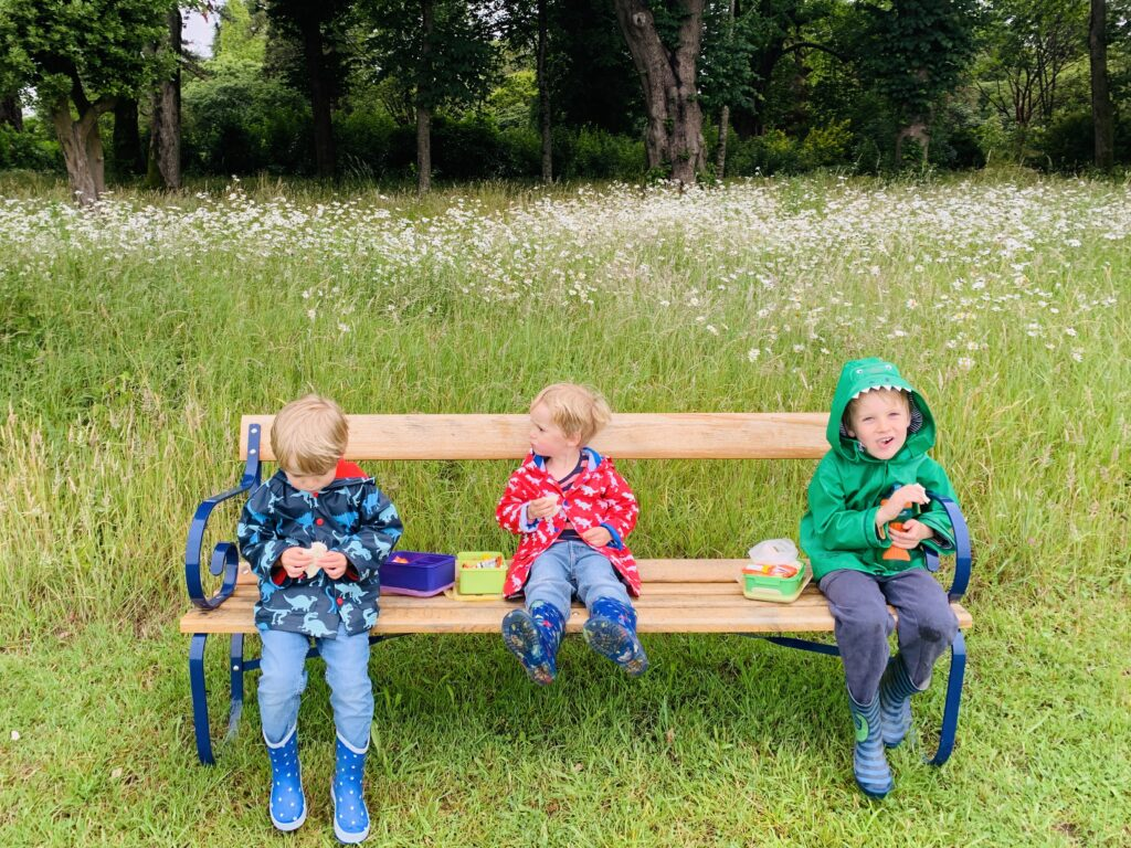 Boys on bench at Saltram one of the best outdoor spaces in Plymouth