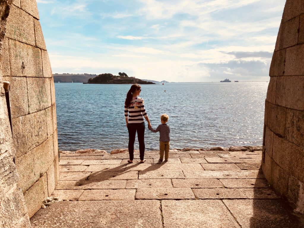 Mum and boy enjoying the view out to see from the Royal William Yard