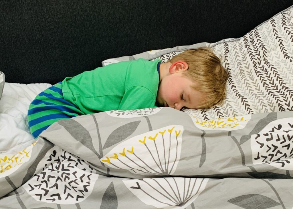 Toddler asleep which helps his immune system during Covid-19