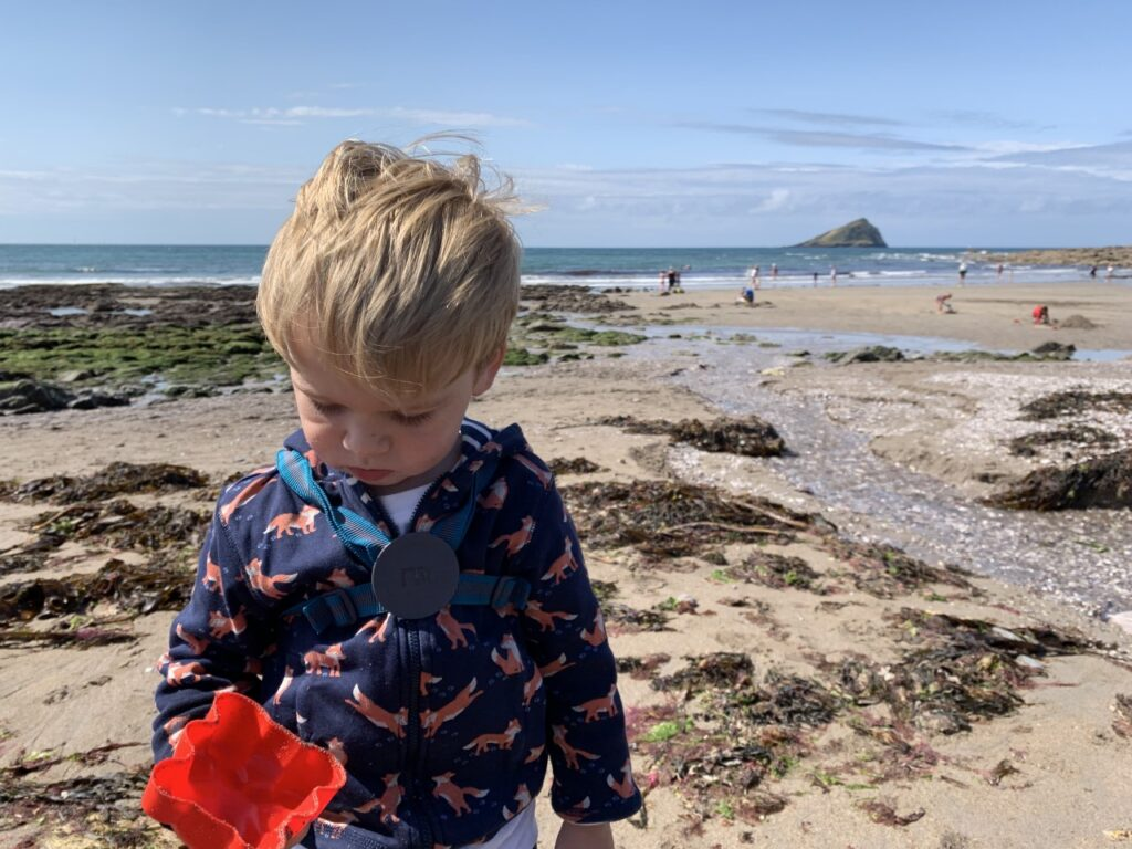 Toddler at Wembury Beach one of the best outdoor spaces in Plymouth