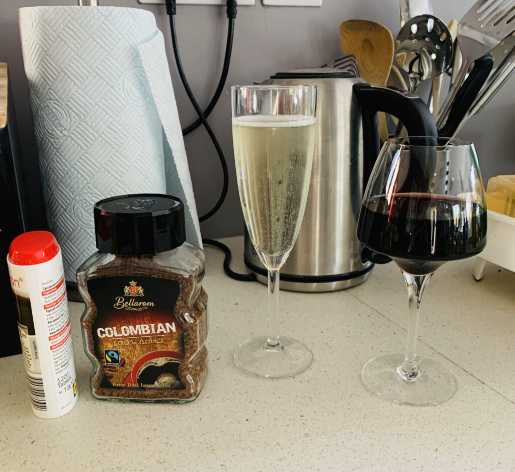 Coffee and prosecco on a kitchen work top