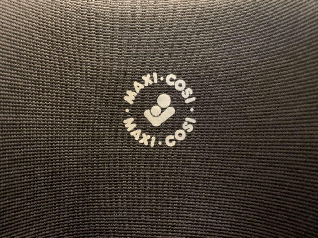 Maxi Cosi log on a car seat