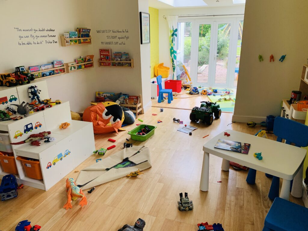 A playroom messy with toys