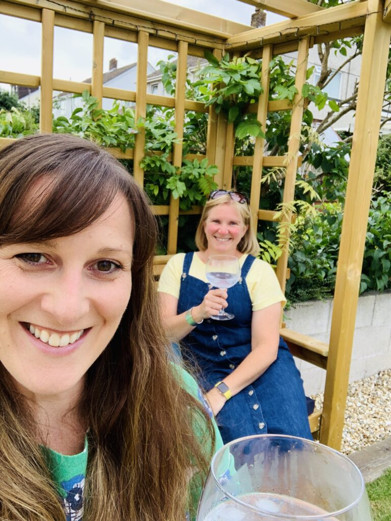 Two women drinking gin in the garden