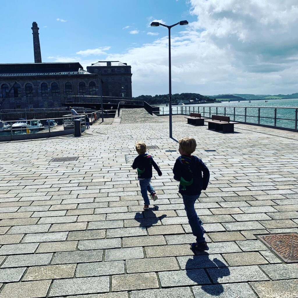 Boys running on the cobbles at the Royal William Yard in lockdown