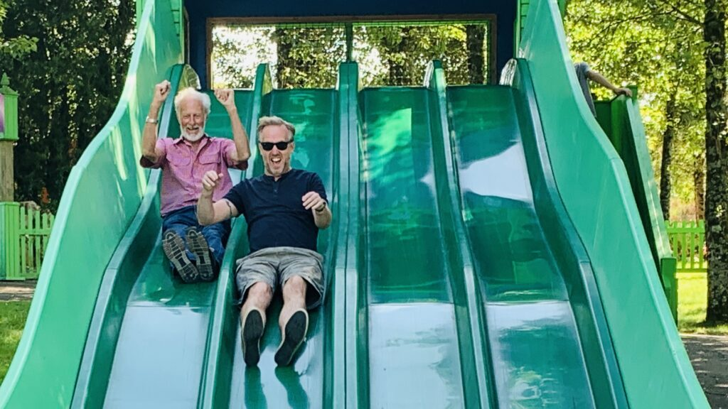 Grandad and Dad enjoying the bumpy slide at Camel Creek