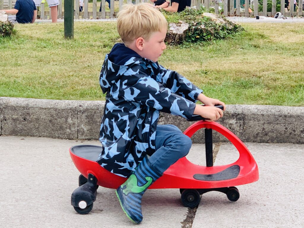 Five year old boy on a diddi car
