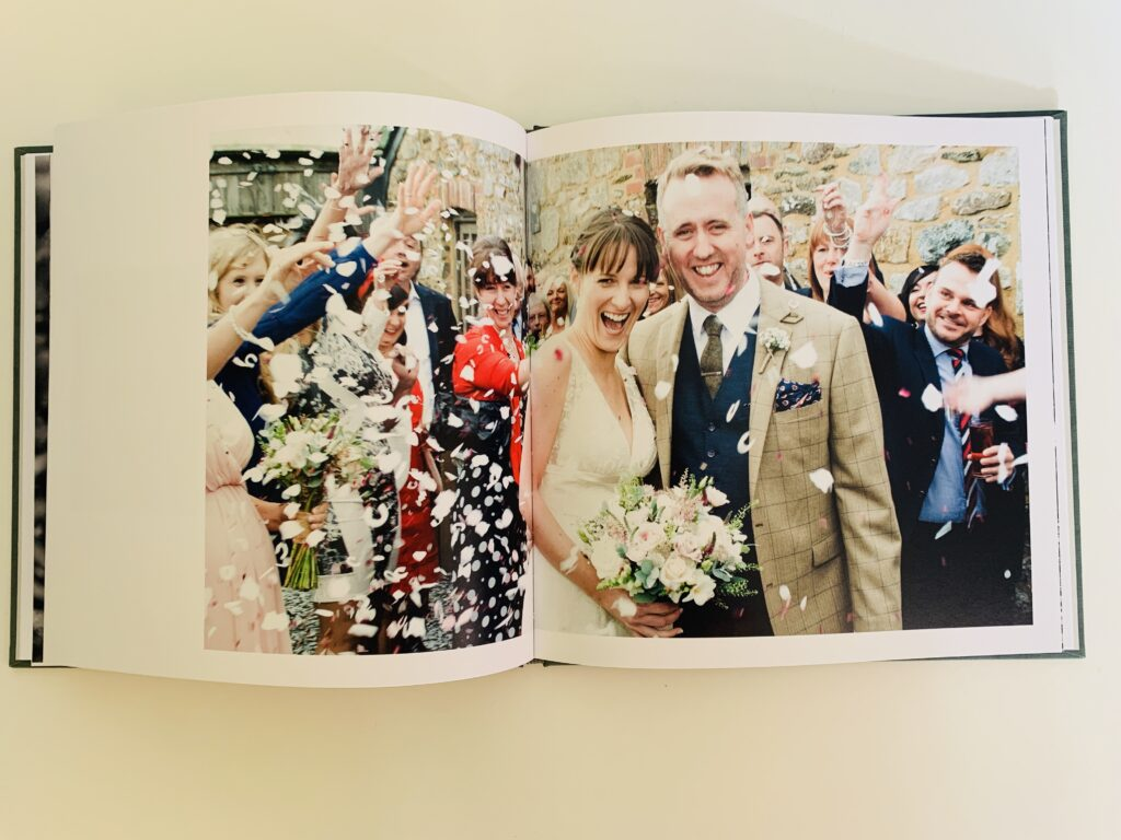 Wedding couple's confetti shot in a Rosemood photo book