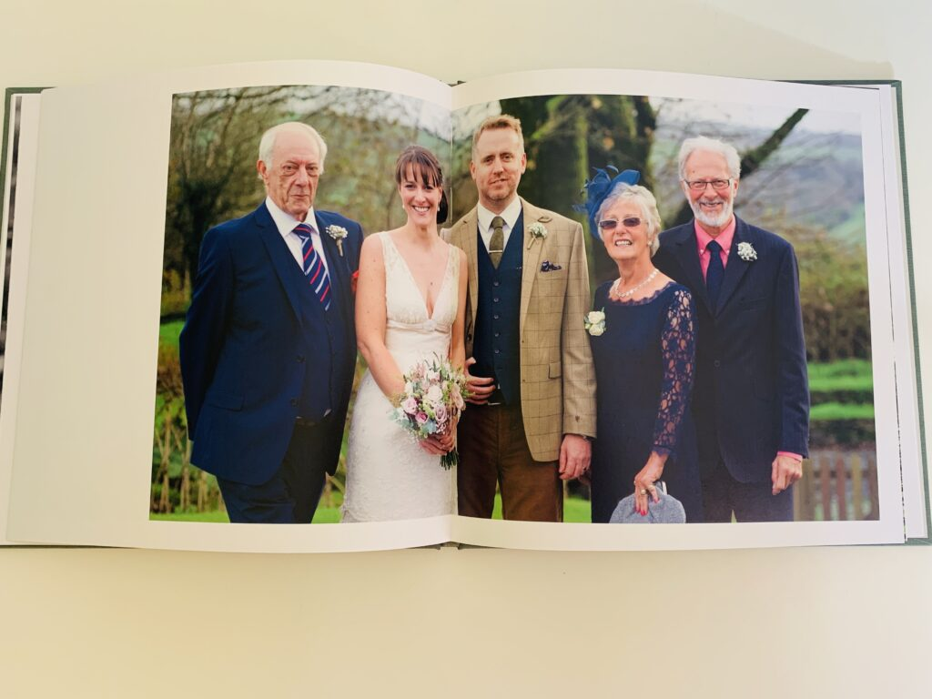 Wedding couple and parents in a Rosemood photo book