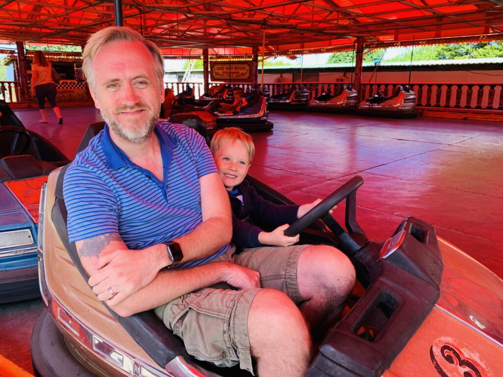 Dad and son on the dodgems