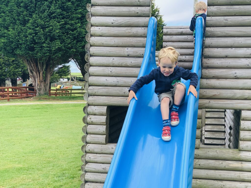 Three year old boy on a pirate ship slide