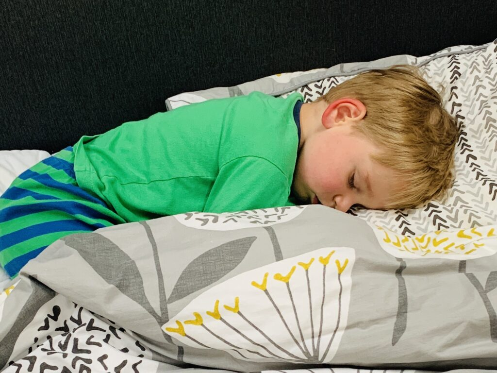 Three year old asleep in parents' bed for a sponsored post with TEMPUR®