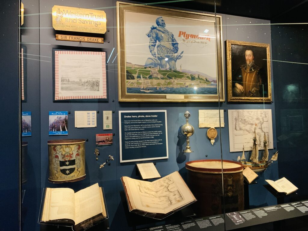 Sir Francis Drake artefacts including his atlas in a glass cabinet in The Box in Plymouth