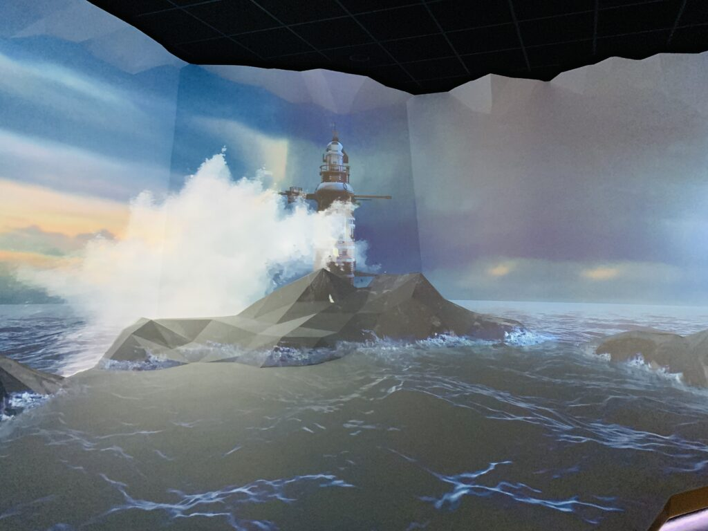 Digital image on a wall of Plymouth Sound and the waves crashing up against Eddystone lighthouse