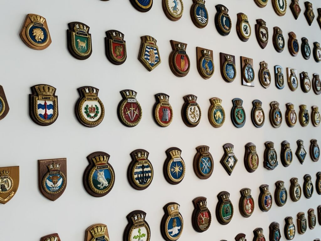 Naval badges cover a wall at the Box museum in Plymouth