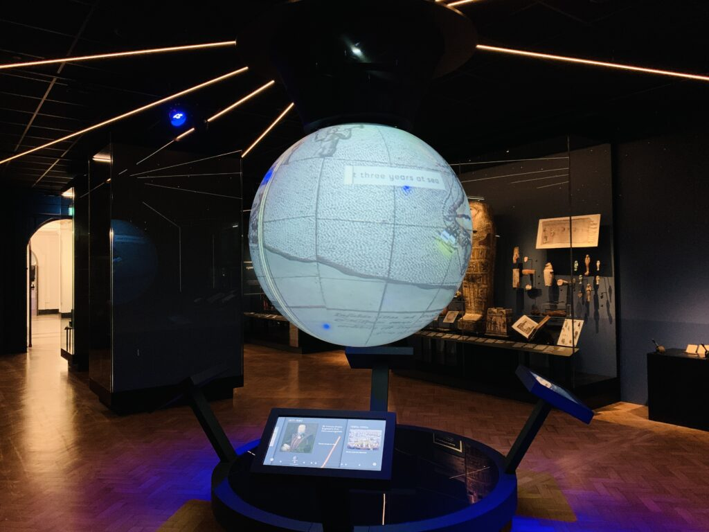 A digital spinning globe showing journeys taken from Plymouth at The Box museum