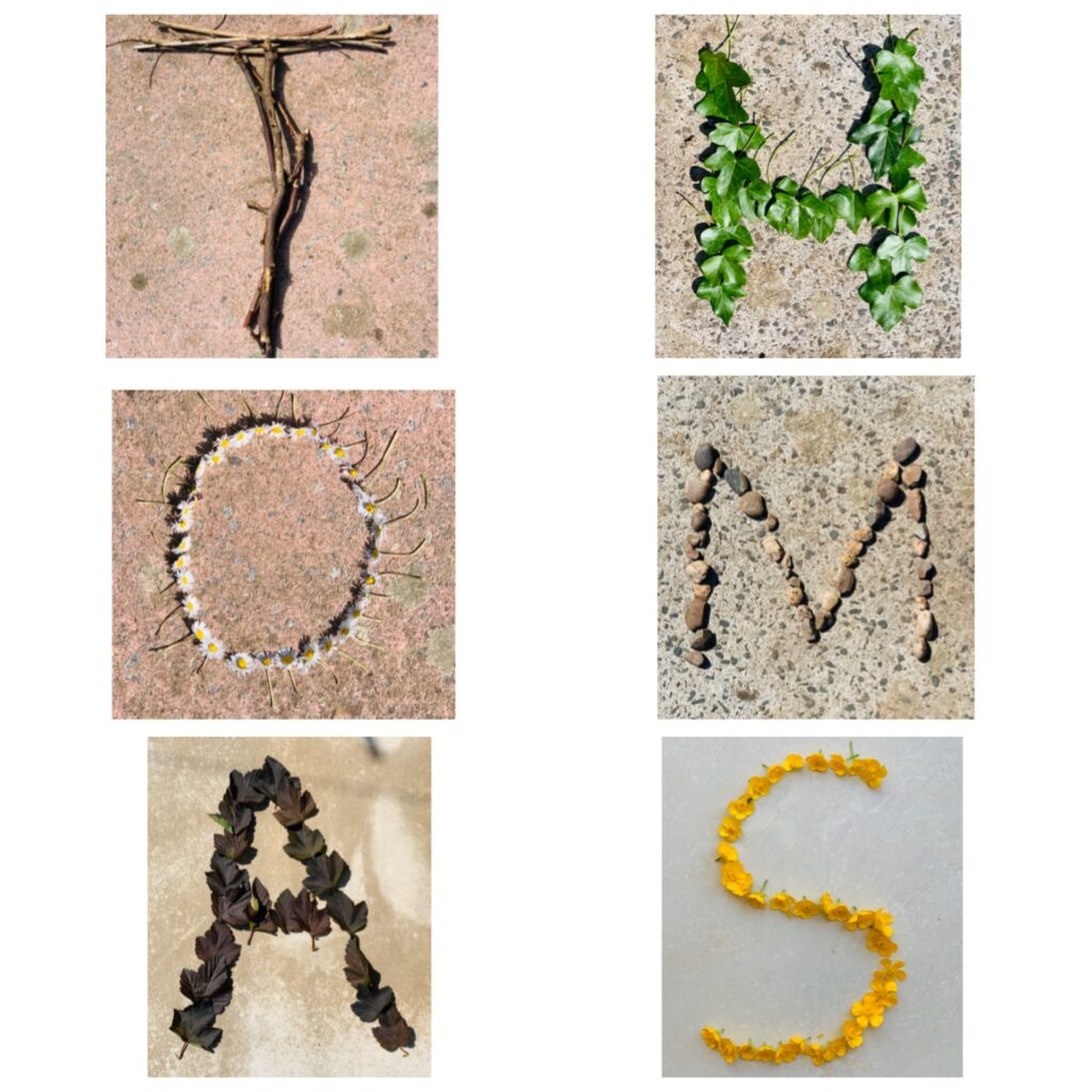 The letters THOMAS spelt out using different twigs, leaves, flowers and leaves from the garden