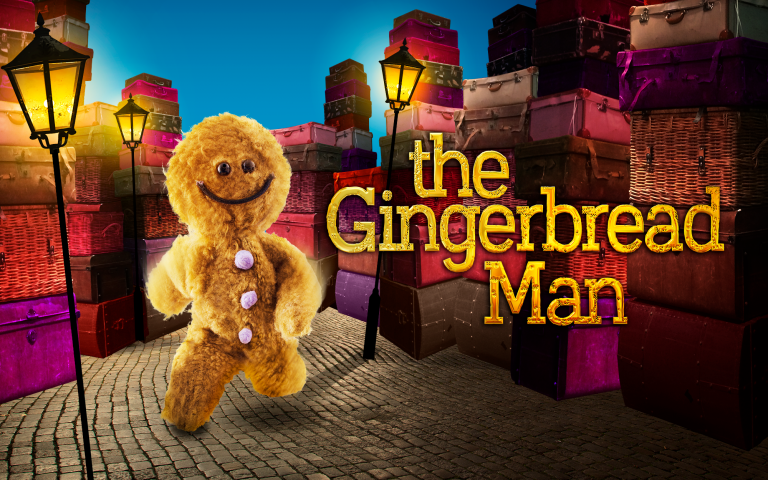 A puppet gingerbread man on a cobbles with a street lamp and street in the background and words The Gingerbread Man over the top of it.