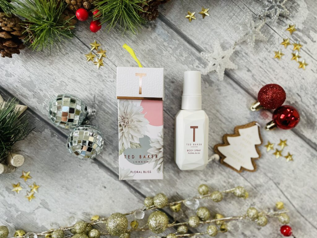Boots Christmas gifts Ted Baker body spray surrounded by christmas decorations