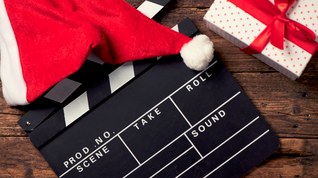 Movie Directors board, santa hat and christmas present for a post on Christmas movies for kids