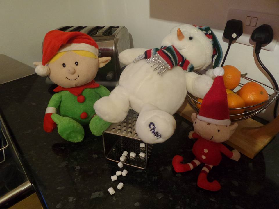 Elf toy grating the snowman