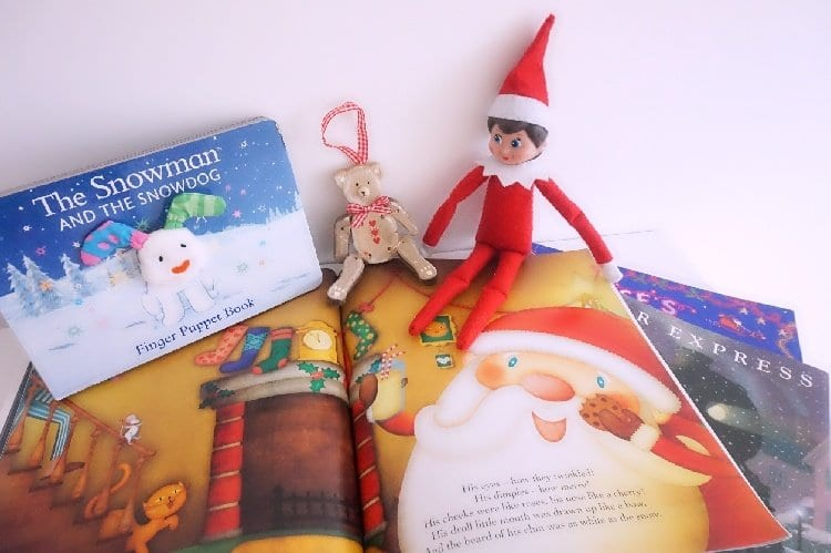 Elf on the Shelf ideas in a pile of books