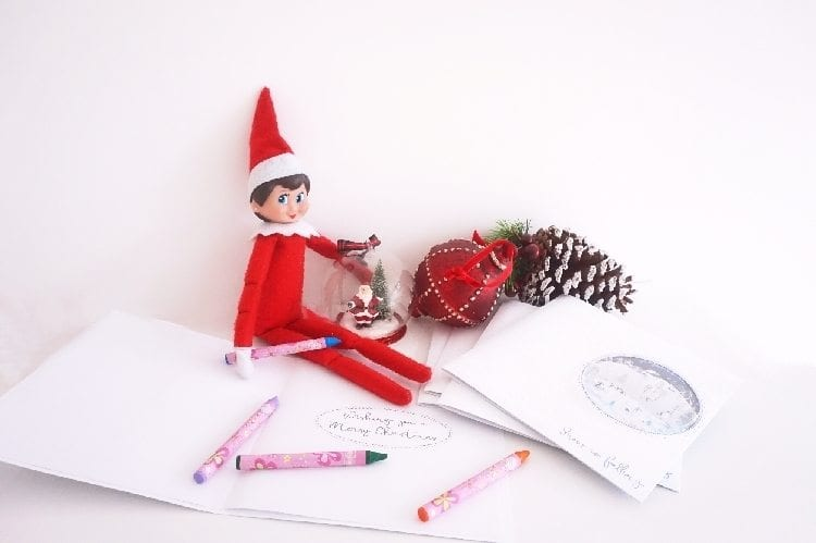 Elf toy writing Christmas cards