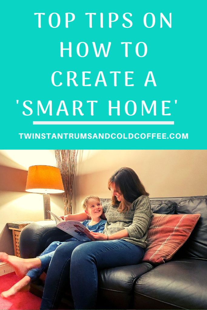 PIN for tips on how to create a smart home with mum and son reading a book on the settee next to a dimmable lamp
