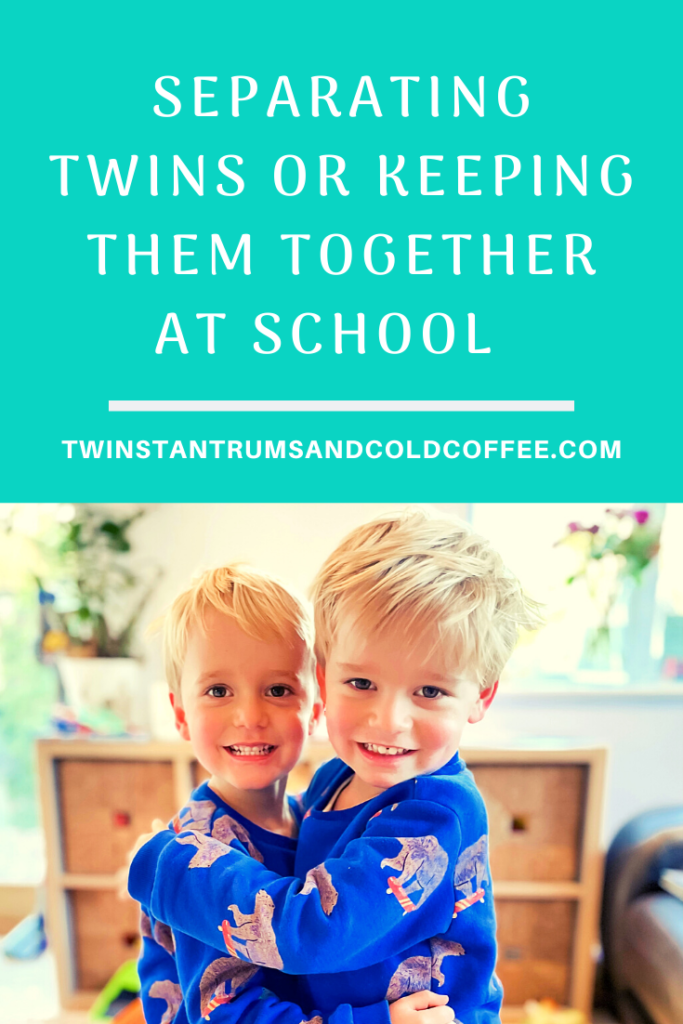 PIN IMAGE OF THREE YEAR OLD TWINS WEARING BLUE SWEATSHIRTS HUGGING EACH OTHER FOR A POST ABOUT SEPARATING TWINS OR KEEPING THEM TOGETHER AT SCHOOL