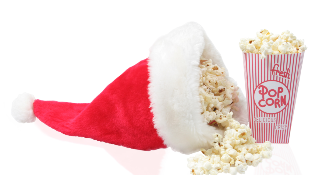 Santa hat full of popcorn for a list of Christmas movies for kids