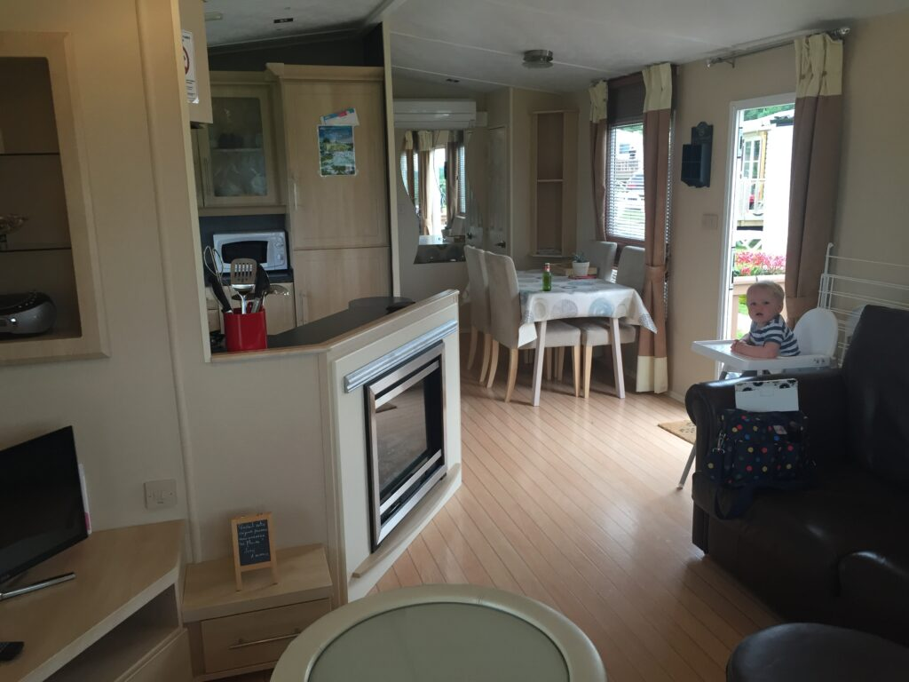 Interior of a caravan in France with a toddler in a high chair