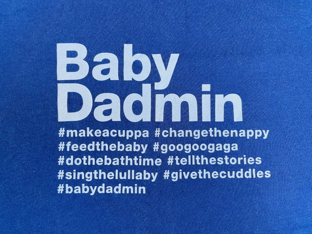 White 'Baby dadmin' slogan on a navy blue t-shirt