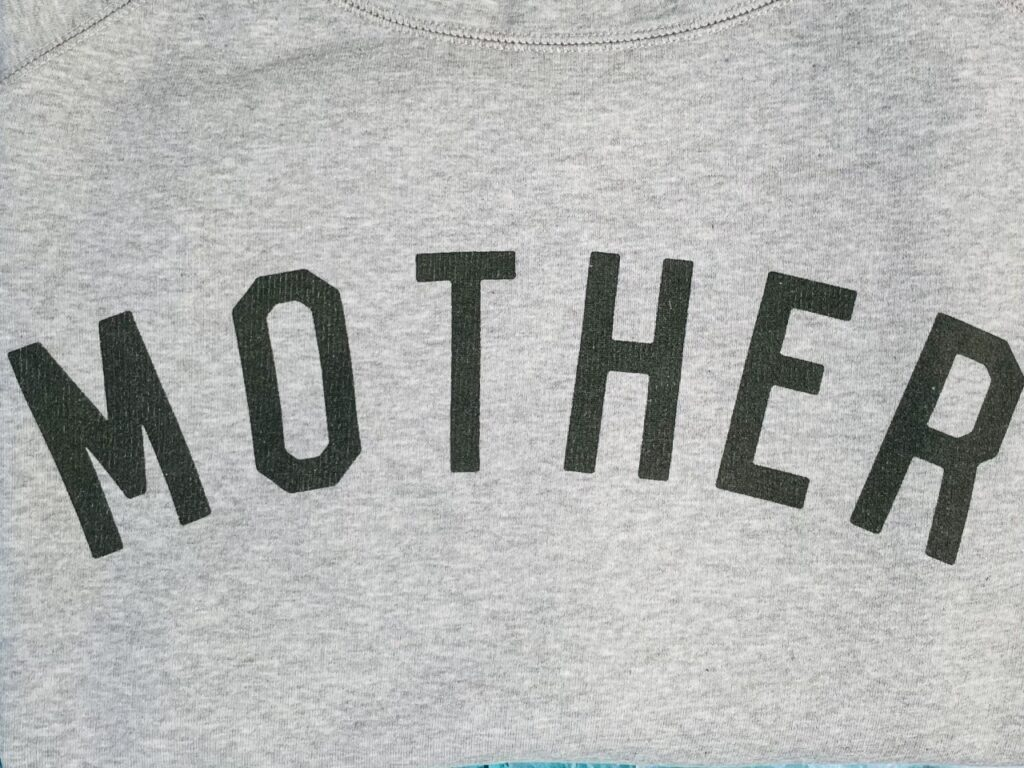 A black 'Mother' slogan on a sweatshirt