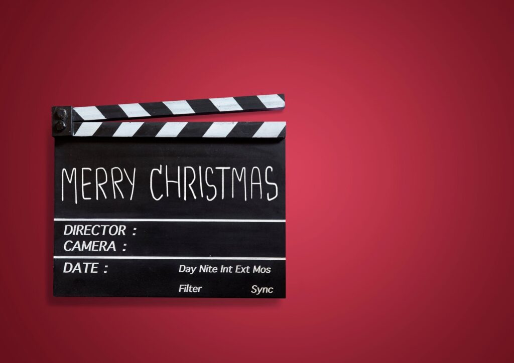 Black director's board saying Merry Christmas as a festive film for an idea for Christmas Eve Boxes