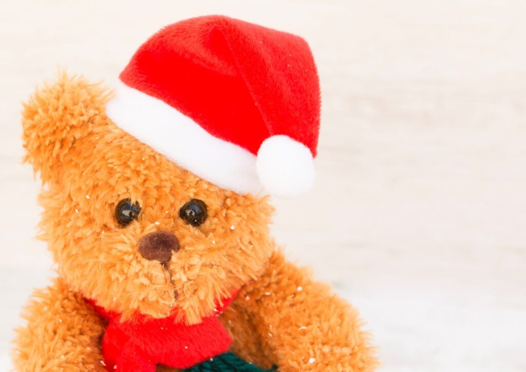 A teddy bear with a santa hat on. An idea for Christmas Eve Boxes.