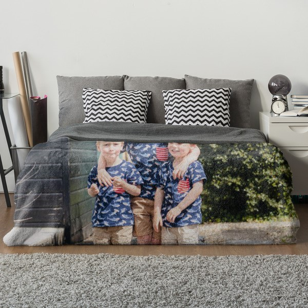 a blanket with a print of three boys on it