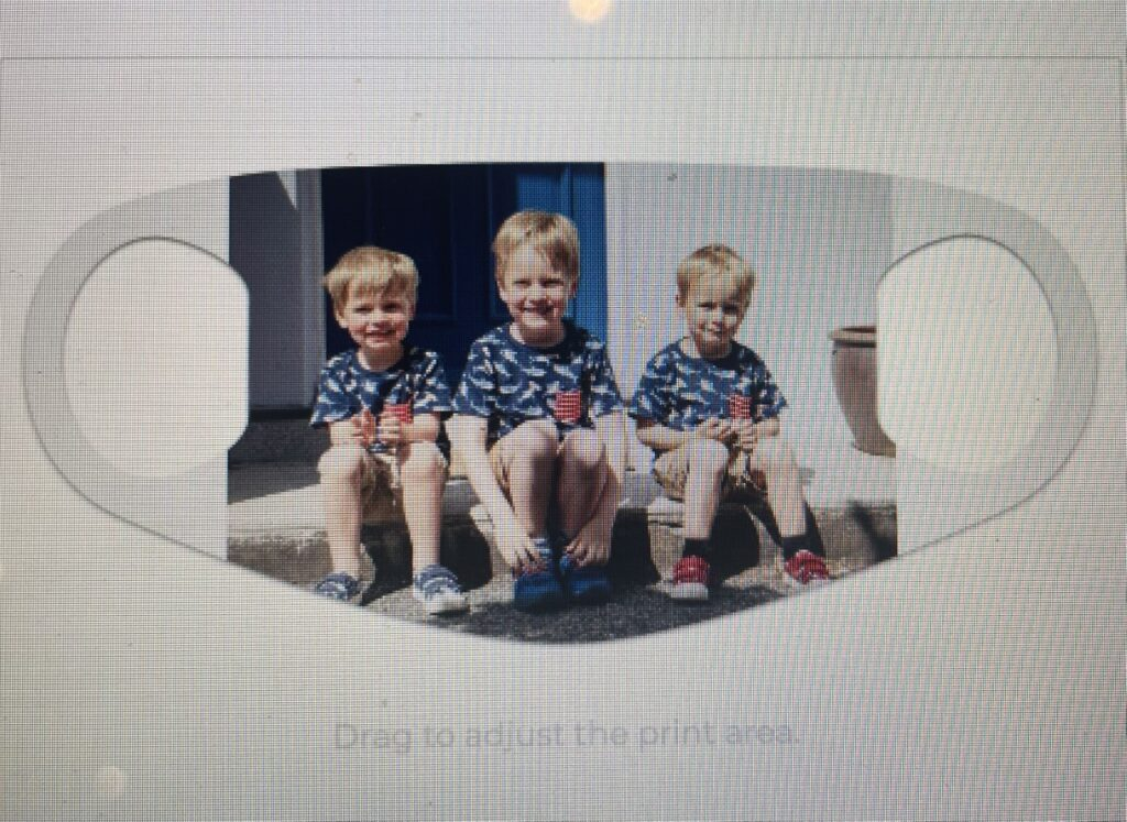 a face mask with a print of three boys on it