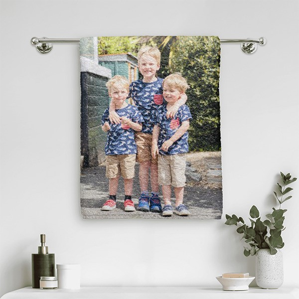 A towel with a print of three boys on it