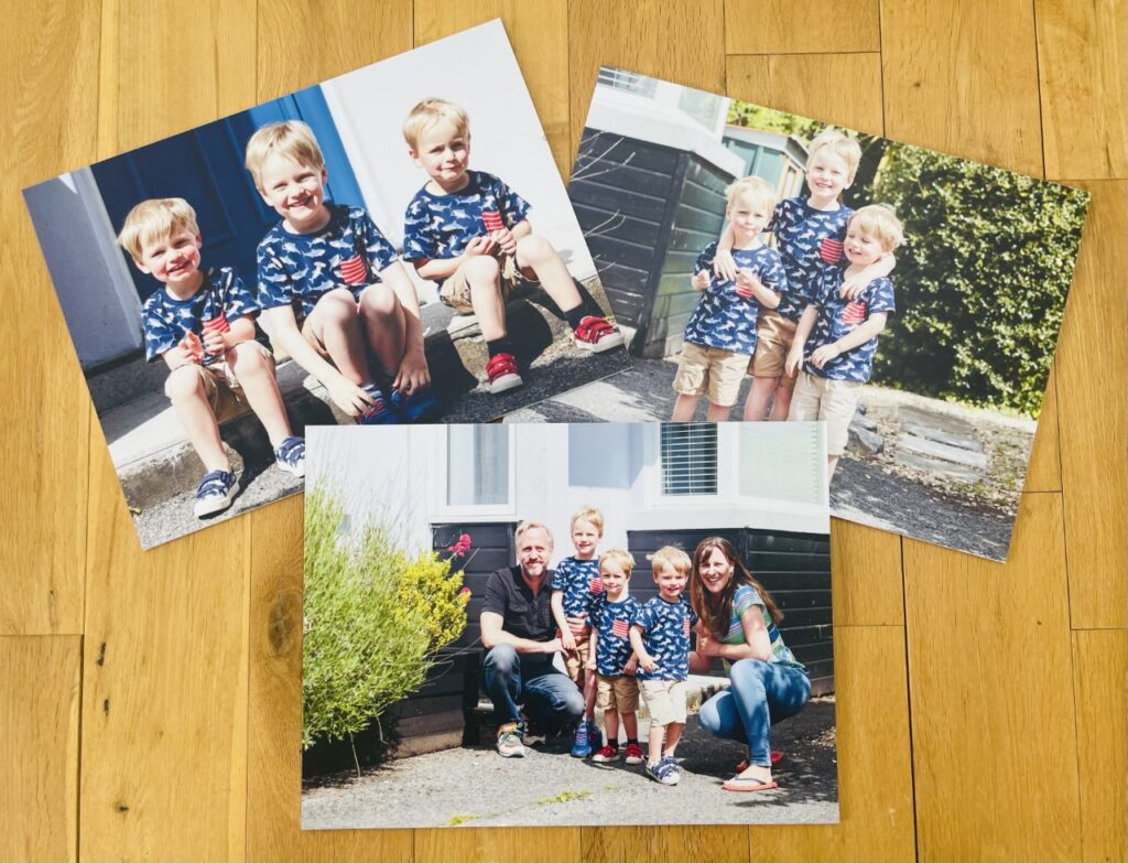 Photo boards of a family on a wooden background