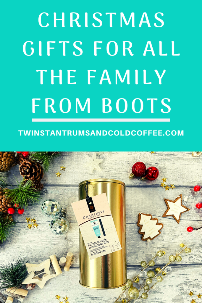 PIN image showing a gold tin of hand cream from Champneys surrounded by Christmas decorations to promote a Boots gift guide