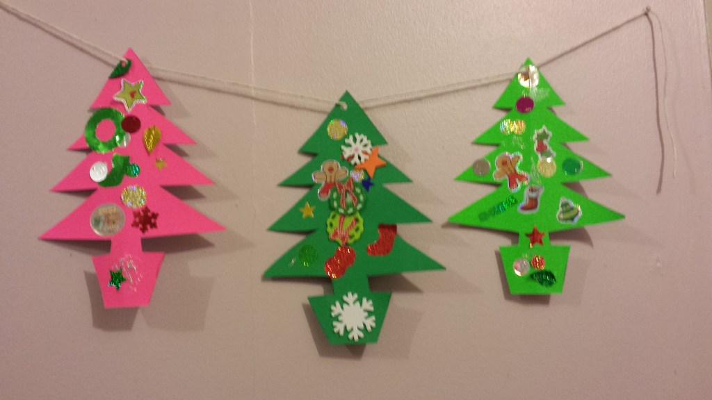 Christmas tree bunting made out of green card and stickers and strung together