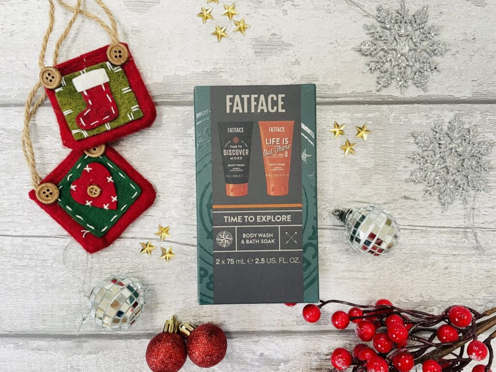 Fatface mini shower duo gift set from Boots surrounded by Christmas decorations on a grey background