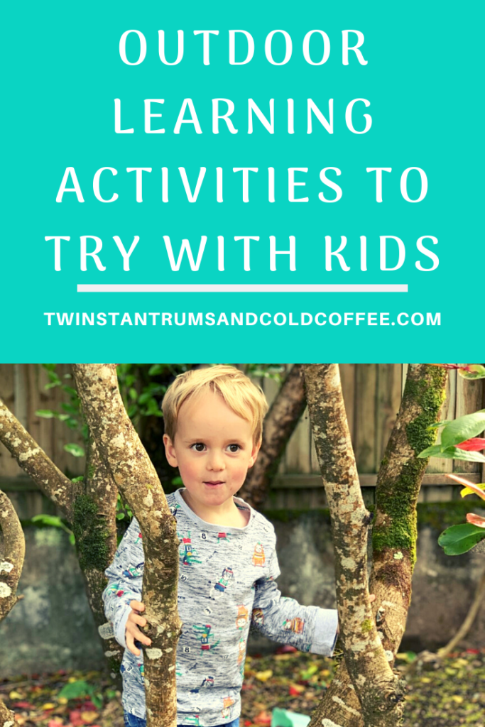 Ideas for outdoor learning activities with a three year old boy stood amongst trees